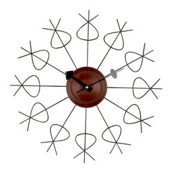 George Nelson - Pretzel Clock - Includes wrought iron time markers. Requires one AA battery not included. High torque quartz movement. Made from metal and solid wood. Made in Taiwan. 2 in. thickness. Overall: 20 in. Dia. (2.2 lbs.)