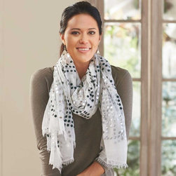 """Viva Terra - Confetti Shawl - Dining at le bistro or strolling the Champs-Élysées, shimmer is in.  This shawl pairs sparkling white and silver disks with a diaphanous modal backdrop to produce a show-off scarf wide enough to double as a shawl. With raw edges, it dresses up or down from daytime jeans to New Year's Eve dinner. Imported.76""""L x 46""""W"""