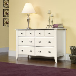 "Sauder - Shoal Creek 6 Drawer Dresser - With country roots and contemporary soul, this inviting, casual appearance offers a stylish alternative to the traditional home office. Tapered legs and sculpted drawer and door edges confirm this design's country origin. Features: -Six drawers for storage.-Bottom four drawers extra deep for added storage.-Made in USA.-Solid Wood Construction: No.-Powder Coated Finish: No.-Gloss Finish: No.-Non Toxic: Yes.-Scratch Resistant: No.-Storage Function: Clothing.-Drawers Included: Yes -Number of Drawers: 6.-Drawer Interior Finish: Wood.-Drawer Glide Material: Metal.-Soft Close or Self Close Drawer Glides: Yes.-Safety Stop: Yes.-Ball Bearing Glides: Yes.-Joinery Type: Cam Screw.-Drawer Dividers: No.-Felt Lined Drawers: No.-Drawer Handle Design: Knobs and pulls..-Clothing Hooks Included: No.-Clothing Rod Included: No.-Foot Design: Tappered.-Cabinets Included: No.-Hardware Finish (Finish: Jamocha Wood): Pewter.-Hardware Finish (Finish: Oiled Oak): Antique Bronze.-Hardware Finish (Finish: White): Antique Nickel.-Hidden Storage: No.-Interchangeable Panels: No.-Mirror Included: No.-Hutch Included: No.-Finished Back: No.-Distressed: No.-Collection: Shoal Creek.-Swatch Available: Yes.-Commercial Use: No.-Country of Manufacture: United States.-Eco-Friendly: Yes.-Product Care: Damp Cloth.Specifications: -FSC Certified: Yes.-EPP Compliant: Yes.-CPSIA or CPSC Compliant: Yes.-CARB Compliant: Yes.-JPMA Certified: No.-ASTM Certified: Yes.-ISTA 3A Certified: Yes.-PEFC Certified: Yes.-General Conformity Certificate: Yes.-Green Guard Certified: No.Dimensions: -Overall Height - Top to Bottom: 33.031"".-Overall Width - Side to Side: 54.646"".-Overall Depth - Front to Back: 18.425"".-Overall Product Weight: 142 lbs.Assembly: -Assembly Required: Yes.-Tools Needed: Hammer and phillip's screwdriver.-Additional Parts Required: No.Warranty: -Product Warranty: 5 years."