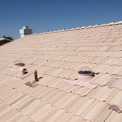Tubular Skylights - These Elite Tubular Skylights were installed 13 years ago and have taken the beating of 110+ degree weather here in Arizona and a few hail storms, This picture was taken about 2 months ago. As you can tell the Acrylic Domes have not faded or hazed. We have not had to maintain/clean these Elite Tubular Skylights.