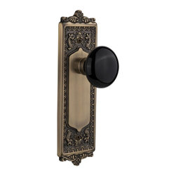 Nostalgic - Nostalgic Single Dummy-Egg and Dart Plate-Black Porcelain Knob-Antique Brass - With its distinctive repeating border detail, as well as floral crown and foot, the Egg & Dart Plate in antique brass resonates grand style and is the ideal choice for larger doors. Add our timeless, kiln-fired Black Porcelain Knob to create a sophisticated, yet classic look. All Nostalgic Warehouse knobs are mounted on a solid (not plated) forged brass base for durability and beauty.