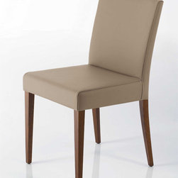 Helena Leather Dining Chair By Cattelan Italia - Classic yet completely modern,the Helena Leather Dining Chair features a beech wood frame and gently padded seat and backrest. Its subtle angles and slightly splayed legs offer support and comfort to the body and the eye. Bring warm luxury into your home with this prime example of Italian workmanship and design.