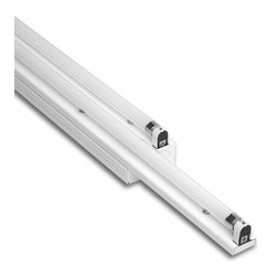 Bartco Lighting Co. - Linear T5 Slide By Side Integral Ballast - Linear T5 Slide by Side  120 Volt features adjustable stagger in a double width low profile linear fluorescent architectural fixture. A simple screw mechanism locks the sliding side of the fixture in place. Available in 14, 21, and 28 watt versions (different lengths). Standard 120 volt electronic high power factor ballast is pre-wired to the lamp holders. Two 120 volt T5 mini bipin linear fluorescent lamps not included. General light distribution. Rotational locking lamp holders. UL listed for dry and damp locations. Dimmensions: 14 watt version is 22 1/2 to 31 inches long, 21 watt version is 34 1/4 to 49 inches long, 28 watt version is 46 1/16 to 66 7/19 inches long.