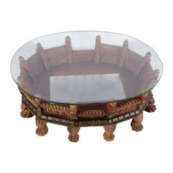 "Wooden Palkhi Coffee Table  With  Glass - Multicolor finish - Name is derived from ""Palkhi"" which was used to carry saints and nobels in India.  The uniquely  designed tables has 12 legs and a glass top."