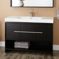 """48"""" Kyra Vanity - Generously sized at 48"""", the Kyra Vanity has two cabinets for stowing toiletries and linens. A central drawer and open shelf provide additional storage."""