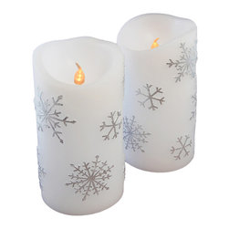 LumaBase Luminarias - Wax Flickering LED Candles- Silver Snowflake- 2 Count - Highlight your home or event with these real wax flickering LED candles. These flameless candles provide warm amber light with a realistic flicker. Perfect to use on tabletops, windowsills or mantels.