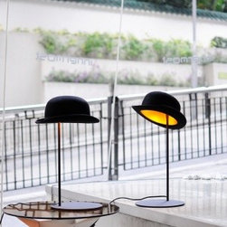Jeeves Table Lamp - This is a fun table lamp! The minimal design is enhanced by the addition of a Jeeves (aka Jeeves and Wooster) style bowler hat. You can even tip the hat to change the look of the light.