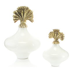Cream Glass Bottles with Ruffled Lid, Set of Two - A splendid arrangement of scrolls forms a sculptural, abstract rocaille atop each of the Cream Glass Bottles with Ruffled Lid.  Wonderful bath accessories and delightfully elegant additions to a living room tablescape, the bottles are sold in well-proportioned pairs, an instant vignette.  The wide-waisted vessels themselves are made of a superb, glossy ivory glass, while the golden caps are molded in acrylic for an unrivaled crispness of metallic form.