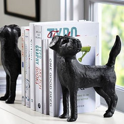 "Dog Bookend, Set of 2 - These two little pups are weighty enough to keep books in place. Made by hand, they bring a sculptural element to the bookshelf or desktop. 8.5"" wide x 3.75"" deep x 9.5"" high Made of cast aluminum with a bronze finish. Set of 2."