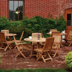 Three Birds - Three Birds Braxton 48 in. Round Teak Patio Dining Set Multicolor - TB151 - Shop for Tables and Chairs Sets from Hayneedle.com! Additional features: Choice of 48-inch round table w/ 4 side or arm chairs 48-inch dining table measures 48 diam. x 29H inches Arm chair measures 22W x 25.25D x 36.75H inches Arm chair seat height: 17 inches Side chair measures 18W x 25.25D x 36.75H inches Side chair seat height: 17 inches Umbrella hole measures 2.5 inches Hand-applied polished finish Chairs fold for easy storage Weather-resistant stainless steel hardware Mortise-and-tenon joinery with locking wood dowels Automatic stainless steel safety lock keeps chairs open Chairs come fully assembled; tables require minor assembly Having the Three Birds Braxton Round Teak Dining Set on your patio is like having your favorite al fresco joint right there in your backyard! Whether you are dining with family or have friends over this handsome dining set is sure to be a big hit every time. Wide slats joined by mitered corners give a distinctive look to the dining table while the chairs fold easily making off-season storage a breeze. The table also has an umbrella hole so you can pair it with a patio umbrella when you need a break from the sun. The generously-proportioned slat seats and contoured slatted backs will seat you and your guests in such comfort that you might never want to get back indoors! Constructed of solid Grade A plantation-grown teak known for its durability the set is designed to withstand the harshest elements and stay like new as the seasons go by. An automatic stainless steel safety lock is built into each chair to ensure it stays open and doesn't pinch your fingers. Designed with straight clean lines for a classic look and feel this dining set will never go out of style and remain the highlight of your outdoor seating area for years to come. About TeakTeak wood is universally recognized for its quality durability and beauty. Teak is a very hard densely grained wood with high oil content. The unique combination of these characteristics makes teak naturally resistant to moisture rot warping shrinking splintering insects and fungus. It is considered the ideal wood for outdoor furniture. If left untreated teak weathers naturally to a beautiful silver gray color. The weathering process will change the color but the grain will still be smooth. There will be no splitting or splintering. You may treat each piece of your set with teak oil if you wish to retain the original wood color. About Three Birds CasualCommitted to providing premium casual living products in an environmentally-friendly way Three Birds Casual focuses on producing high quality plantation-grown teakwood furniture for the outdoor living market. Three Birds prides itself in not only delivering premium outdoor products but also choosing partners that reflect the high business standards and ethics that are foundations of success for their business.