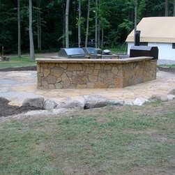 "Outdoor Kitchen by DYI - Indoors Out - An outdoor kitchen installed by Dean & Derek from DIY Network.  The flagstone patio and ""webwall"" on the kitchen units is Carmel Gray Flagstone.  Countertop is natural quarried 2 1/4"" sandstone slabs.  Stone provided by Sturgis Materials."