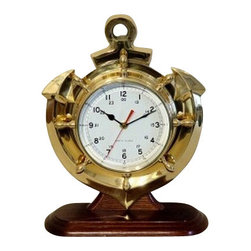 """Brass Anchor  & Ship Wheel Clock w/ Base - The Brass Anchor Clock w/ Base measures 13"""" x 10.5"""" x 2"""". This clock features hand crafted brass shaped into an intricate anchor mounted to a hardwood base. If you look carefully at the clock you can also see the spokes of a brass ship wheel surrounding the clock. This clock makes a great gift and is a beautiful addition to the home, office or restaurant/bar. It will be admired by all those who love the sea."""
