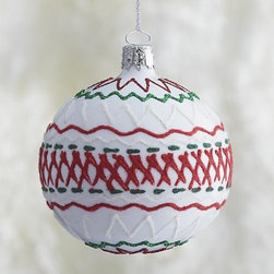 White Ric-Rac Ball Ornament - A stylized, glittering take on ric-rac ribbon combines zigzags and cross-hatching in our artisanal modern glass ornament group. Each is handcrafted, hand-painted and decorated by German craftsmen in a classic holiday palette of green, white and red.