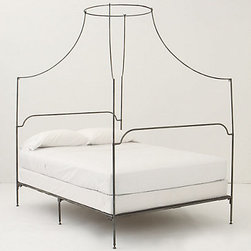 """Anthropologie - Italian Campaign Canopy Bed - This is a beautiful """"forever"""" bed — for sure the star of any room! Since the footboard and the headboard are the same height, you could position it horizontally against a wall like a large daybed to allow for ample floor space."""