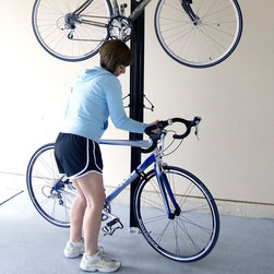 "Frontgate - Up & Away Bike Rack - Aircraft grade T-5 aluminum. Padded feet grip any surface. Top plate has foam to protect the ceiling. Storage arms adjust on a 6' area to fit almost any style of bike. Velcro straps stabilize front wheel to frame when bikes are stored. Conveniently store two bikes in your office, garage, or almost anywhere there is a flat solid ceiling - without using valuable floor space - with the Up & Away Bike Rack. A ""no holes"" tension mounting system easily holds most styles of bikes. Adjust the top and bottom extenders independently to fit 7- to 11-foot ceilings.. . . . . Accommodates ceiling heights from 7' to 11' . 200 lb. capacity. Stores two bikes. Minor assembly required; view instructions (PDF format)."