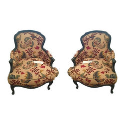 French Floral Upholstered Bergeres - A Pair - A classically elegant pair of French Bergere arm chairs. The chairs have been newly reupholstered in English floral linen and feature distressed green painted woodwork.