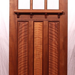 """The Lucky Seven Bungalow Entry Door - Brian Lee Designs/MendocinoDoors.com The Lucky Seven Bungalow Entry Door.  Made of vertical Old Growth Redwood.  36"""" x 80"""" x 1-3/4""""   This Entry door came pre-hung with a pre-made arched-top door jamb and 4 Bronze ball bearing hinges.  The panels are VG Curly Redwood."""