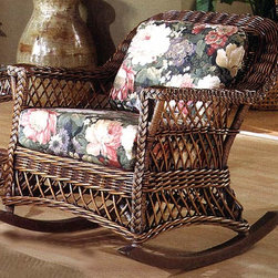 Spice Island Wicker - Wicker Rocker with Cushion Seat (Husk Chocolate - All Weather) - Fabric: Husk Chocolate (All Weather)Rattan is known for its strength and this wicker rocker with deep cushioned comfort will be a beautiful and enjoyable asset in your home.  Gentle contours define the sides and shawl back.  Shapely apron and sides are open and framed by classic braiding.  Rock away a relaxing afternoon or evening in this beautiful solid rattan wicker rocking chair.  You'll want to add a matching Bar Harbour end table or one of our quality matching coffee tables to add table space to your fine rocker seating choice. * Solid Rattan construction. Brown Wash Finish. Includes cushions