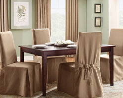 Sure Fit - Sure Fit Cotton Duck Long Dining Room Chair Cover - 33072 - Shop for Chair and Slip Covers from Hayneedle.com! The Straight Skirt with Ties cover is a one-piece furniture cover with patented seat elastic four sets of ties and inner pleats to minimize tucking. It features one set of ties on each corner to ensure a secure and attractive fit. About Sure FitSurefit Inc. is widely known for its attractive quality furniture covers slipcovers and decorative accessories. The success of their ready-made furniture slipcovers and accessories is based on extensive experience providing cost-effective decorative solutions made to fit in a broad range of styles to meet the needs of all customers. Sure Fit's furniture slipcover product line includes slipcovers for sofas loveseats chairs oversized chairs wing chairs dining room chairs recliners ottomans and folding chairs as well as furniture and pet throws. Sure Fit also sells coordinating decorative pillows. Sure Fit is dedicated to quality product with rigorous durability and performance standards that are second to none. Many patterns feature dual-action Scotchgard Protector to repel and release stains. Home of the Ten Minute Makeover Sure Fit provides an attractive and affordable solution for consumers who need to protect furniture from children pets and general wear or want to quickly and cost-effectively upgrade their furniture and enhance the appearance of any room.Please note this product does not ship to Pennsylvania.