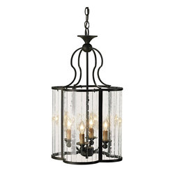 Currey and Company - Rupert Lantern - Curved multi-panel glass sides form a cloverleaf design in this unique piece. The wrought iron frame is finished with the Old Iron finish.