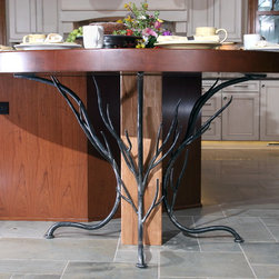 Historic Renovation - Custom cherry table and iron base to resemble tree branches
