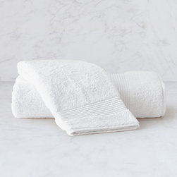"Frontgate - Aegean Hand Towel - Long-staple cotton harvested from Turkey's Denizli region, renown for growing the world's finest cotton. Soft, single pile terry towel. Yarns are specially spun and twisted for optimal softness and absorbency. Wide, 4"" dobby with pick stitch design. Gently dries your skin with its soft touch. Generously sized at 30"" x 60"", our Agean Shower Towel is made of 100% pure Aegean cotton harvested from Turkey's Denizli region and loomed to the optimum weight of 600 gsm. The beautifully executed traditional Turkish loop produces a supersoft towel that is highly absorbent and substantial without being too thick—and it's the basis of our Aegean Shower Towel. Long-staple cotton harvested from Turkey's Denizli region, renown for growing the world's finest cotton .  .  .  .  . Monogram available on the dobby . In White, Blue Indigo, Ivory, Khaki, Dune, Port and Slate Blue . Machine wash and dry . Made in Turkey. Please note, personalized items are nonreturnable."