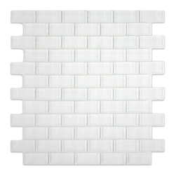 "Subway Tile Outlet - White 1x2 Mini Glass Subway Tile - The White Mini Subway Tile is made from the strongest stain-resistant crystal clear glass. These tiles have a 8mm thickness that increases their durability and the depth of their color making them truly beautiful subway tiles. These subway tiles can be used for commercial or residential construction in either a wet or dry environment.    All Mini Subway tiles are sold in sheets tiles making one square foot per sheet. The individual tiles measure 1""x2""."