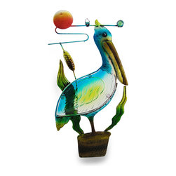 Zeckos - Colorful Right Facing Pelican Sculpture with Glass Insert Wall Hanging - This pelican promises not to take flight, and will stay perched on his piling and proudly take up residence on your wall or window Crafted from metal, this fun sculpture is hand-painted in tranquil ocean hues sure to delight and features a colored glass insert body. Measuring 14 inches (36 cm) long, 8 inches (20 cm) wide and 1 inch (3 cm) deep with an attached hanger, this metal pelican wall hanging will accent your home, office, indoor garden or shop Standing amongst the cattails, this coastal inspired pelican sculpture is sure to receive rave reviews.