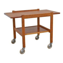 Pre-owned Mid-Century Teak Tea or Bar Cart - A handsome two-tiered serving or bar cart designed with the spare simplicity that is the hallmark of Mid-Century Swedish design. Finished with brushed nickel wheel casters for easy mobility.