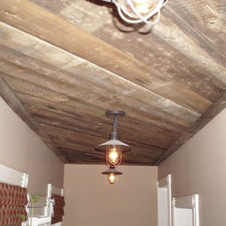 """BrownBack - Reclaimed barn siding has many applications from being re-used as exterior siding, interior paneling and """"brownboard"""" (the backs of siding) for exposed roofs and ceilings.  When the backside is used on a ceiling or a wall, it is as if you are in a barn looking at the original ceiling or walls.  Brownboard can also be interior boards in a barn such as loft flooring or den walls.  Whatever the origin, brownboard refers to the unweathered, unpainted side of a piece of barnwood.This material can be run horizontally or vertically.  If run horizontally, it must be milled to like widths, so you can create even rows when installing.  If run vertically, random widths can be used.  In either direction, milling the back is optional.  Milling the back of the board will create a more even appearance.  If not milled, we do supply material all from the same """"batch"""" of siding, so the thickness variations do not bother most people.  Without milling, there is a more primitive look and a less than perfect seam. Price listed as average.  $4.50-$6.50/sq ft"""