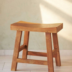 """Viva Terra - Saddle Seat Teak Stool - Our hand-carved reclaimed-teak stool has a gently curved seat and is naturally resistant to humidity, making it an ideal accent in the bathroom. 19""""L x 14""""W x 19""""H"""