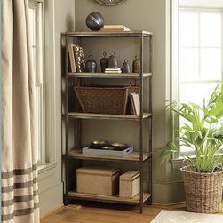 Ballard Designs - Durham Tall Bookcase - This bookshelf works well in so many spaces thanks to its clean architectural design and midrange size. The planked wood shelves are distressed for a little-bit-lived-in look.
