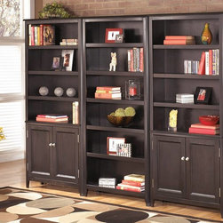 """Carlyle Large Door Bookcase - The sleek design of the contemporary styled """"Carlyle"""" home office collection brings a rich sophistication into any home. A rich, dark finish accented with satin nickel color hardware adorns this home office furniture creating the perfect example of contemporary style. With ample storage space and a comfortable design, this office furniture is as practical as it is stylish. Create the perfect home office with the """"Carlyle"""" home office collection."""