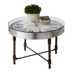 Uttermost - Uttermost Cassem Clock Table - Cassem Clock Table by Uttermost Riveted, Vintage Aluminum Clock Frame Is Upturned Onto A Weathered, Industrial Metal Base In Rusted Patina With Gear Details. Subtle Dents And Ripples Reflect Its Hand-hammered Construction. Motorized Clock Encased Beneath Clear Glass Uses One AA Battery.