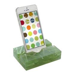 Fossil Faux Studios / groove - Groove iPhone/Smartphone Stand, Wheatgrass, Iphone4 - The latest 'must have', these groove iPhone stands come in an array of yummy colors for you to choose from and you can mix or match styles if you already have a groove iPad/tablet stand. Whether alone or paired with the groove iPad/tablet stand, its a stunning statement of modern minimalism aesthetics. Geeks and non-geeks alike love the translucent beauty and simplicity of the groove iPhone stand and it makes a great, affordable gift.