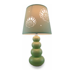 Green Stacked Accent Lamp w/Shell Cutouts Fabric Shade - Featuring a complementing fabric shade with cutouts in the shape of seashells, this ceramic lamp is perfect in nautical, beach and ocean themed homes and is sure to create a relaxing ambiance with its soft green glossy finish and stacked style while the seashell shadows dance on your walls! It`s great as a bedside accent or to playfully highlight your entryway. It uses one 60 watt Type A or 13 watt CFL bulb (not included), and measures 15.25 inches (39 cm) high, 4.25 inches (11 cm) in diameter with a 60 inch (152 cm) long white cord, while the plastic diffuser lined shade is 7 inches (18 cm) high and 8 inches (20 cm) in diameter. It`s an elegant accent in a nursery or child`s room, and makes a wonderful housewarming gift!