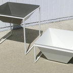 """TRAPA Modular Planter - The Trapa system of modular planters offers the best in design and quality with the flexibility to interchange components as you please. Thick 11 gauge 100% recycled domestic aluminum pots in 6"""" or 12"""" heights can be mated with either of the two steel stand sizes (12"""" or 24"""" height) for multiple looks and variations. Stainless frame feet and a triple layer powder coat add an environmentally sound and extra durable finish to these original solutions that are suitable for both indoor and outdoor use."""