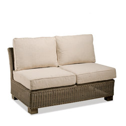 Thos. Baker - Sanibel Wicker Outdoor Armless Loveseat - Crafted using fade-resistant nDuraA all-weather wicker hand-woven over powder-coated aluminum frames, each piece in the sanibel collection boasts a transitional style that compliments both contemporary and traditional outdoor spaces.Plush cushion sets are covered in premium Sunbrella outdoor fabrics made-to-order in your choice of 24 solid and textured colors or 16 premium woven patterns.Signature or premium cushion sales are final and ship in 2-3 weeks.