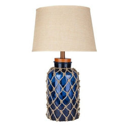 Surya - Amalfi Navy Blue Nautical Fillable Lamp - Beach cottage perfect lighting accessory.  Presenting our new 30 inch tall Amalfi Navy Blue glass base lamp covered with nautical style netting and finished with a beachy feeling round natural burlap fabric shade.  Cork-like base top can be removed to add seashells, seaglass, beach treasure or even pretty wine corks!