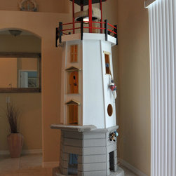 Lighthouse cat tower - This was the first cat tower Square Paws designed and built, modeled loosely after the Louisbourg Lighthouse in Nova Scotia, Canada.