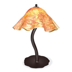 Mathews & Company - Wrought Iron Diamondback Table Lamp with Large Glass Shade - A part of our popular Diamondback collection, there is nothing old fashioned about this modern masterpiece. Featuring a hand blown Large Glass Shade with swirls of vibrant color, this table lamp, crafted by the artisans at Matthews & Company, is nothing less than a work of art. The fluted edges create a sense of delicacy, while the gently curving wrought iron lamp stand lends simple, natural elegance to the modern design. And while the lamp may appear to exhibit a precarious lack of balance, a circular wrought iron base provides all of the needed stability. Pictured in Garden Blush shade and Black finish.
