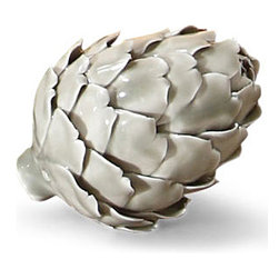 Kathy Kuo Home - Thistle Putty Artichoke Porcelain Sculptures - Set of 3 - The artichoke is the new pineapple. While pineapples are known to symbolize a welcome, artichokes symbolize hope. Cast in a natural putty color, these three delicate artichokes enliven a soffit in the kitchen or add some lightness to a bookshelf. Grouped together for impact or scattered throughout an area, these hopeful hearts are a welcomed addition in any home.
