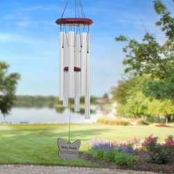 Chimes of Your Life Personalized Butterfly Wind Chime - Hand-tuned to ancient pentatonic notes the Chimes of Your Life Personalized Butterfly Wind Chimes produce a calm soothing sound that relaxes your body and mind and brings a sense of tranquility to your surroundings. But what sets these personalized wind chimes apart from the rest is that each butterfly wind chime is engraved with your own thoughts and feelings and custom made just for you! Each side of the chime's wind sail can be inscribed with up to 300 characters (per side) of text. Your personal message is expertly engraved on both sides of the silver or bronze wind sail in black creating a high-contrast easy-to-read inscription. A professional graphic artist chooses the formatting spacing between paragraphs centering and font size based on the wind sail design and content of your inscription creating the perfect wind chime for you. The top pieces and strikers of these chimes are made of Ash hardwood stained in beautiful warm red and finished with clear semi-gloss polyurethane to protect the wood for years to come. The pentatonic-tuned tubes are made of non-rusting anodized aluminum and coated with a lasting weather-resistant bronze or silver finish. The acrylic butterfly-shaped wind sail comes in matching silver or bronze. Available in 19-inch 29-inch or 39-inch overall lengths. An excellent way to remember special days and people the Chimes of Your Life Personalized Butterfly Wind Chimes make thoughtful gifts that are sure to be cherished for years to come. Personalization: A professional graphic designer will format your message to fit the wind sail perfectly based on all elements - sail shape and the content of your inscription. Inscription is limited to a maximum of 300 characters (per side). Wind sail area provides enough space for a small poem. Message will be engraved on both sides. Personalized wind chimes make appropriate gifts for weddings anniversaries retirement and memorials for people or pets