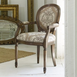 Melange Chelsea Accent Arm Chair - If chairs were people, the Chelsea Accent Arm Chair would be a Duchess. She's decidedly feminine, European in style, and obviously went to finishing school. She wears only the finest, with her Golding Westminster linen upholstery, and is constructed of hardwood solids and veneer - so her reign can last for years. The distressed finish gives a look of history, and the scrollwork makes sure you know how fancy she is.Not available for sale in, or delivery to, the state of California.About Hooker Furniture CorporationFor 83 years, Hooker Furniture Corporation has produced high-quality, innovative home furnishings that seamlessly combine function and elegance. Today, Hooker is one of the nation's premier manufacturers and importers of furniture and seeks to enrich the lives of customers with beautiful, trouble-free home furnishings. The Martinsville, Virginia, based company specializes in lifestyle driven furnishings like entertainment centers, home office furniture, accent tables, and chairs.Construction of Hooker FurnitureHooker Furniture chooses solid woods and select wood veneers over wood frames to construct their high-quality pieces. By using wood veneer, pieces can be given a decorative look that can't be achieved with the use of solid wood alone. The veneers add beautiful accents of color and design to the pieces, and are placed over engineered wood product for strength. All Hooker wood veneers are made from renewable resources and are located primarily on the flat surfaces of the furniture, such as the case tops and sides.Each Hooker furniture piece is finished using up to 30 different steps, including 13 steps of hand-sanding and accenting. Physical distressing is done by hand. Pieces receive two to three coats of solid lacquer to create extra depth and add durability to the finish. Each case frame is assembled using strong mortise-and-tenon joints, which are then reinforced by mechanical fasteners and glue. On most designs, end panels extend to the floor to add strength and stability. Panel-style furniture features strong panel and frame construction to help avoid warping.Your Hooker furniture features finished case interiors to eliminate unsightly raw wood and to help protect items you may store inside drawers or cabinets. Drawer parts are given a urethane or lacquer finish to create smooth action and durability. All drawers use dovetails, either English or French, for years of problem-free use. Drawer bottoms are constructed from plywood and attached to the plywood drawer sides via the use of hot glue and/or wood glue blocks. Most drawers are full width, depth, and height to provide the maximum amount of storage space.