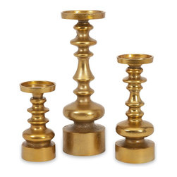 iMax - iMax Karenza Candleholders - Set of 3 X-3-36698 - The set of three Karenza candleholders feature a rich gold finish that is one of the hottest looks in homes! Add just a touch of this new modern metallic to warm up any space with a subtle accent to your favorite pillar candles.