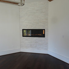 Contemporary Indoor Fireplaces by Showroom Partners