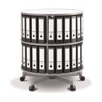 Spin N File Two Tier Rotary Binder Storage Carousel - Conserve floor space with the slender and mobile Spin N File Two Tier Rotary Binder Storage Carousel. This 32-inch diameter storage solution for your home or office features heavy-duty laminated shelves and a five-point wheeled base. Each shelf is designed to hold over 100 lbs. and is positioned to accommodate letter-size binders and books. The customizable design of the tiers also makes it possible to add additional shelving when needed. But the real highlight of this piece is the full rotating function that allows you to store more documents in one place that's neatly organized and easily accessible. Measures 32 diam. x 34H inches.