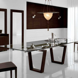 Targa Extensible Dining Table By Cattelan Italia - Sleek modernity is at the center of the Targa Extensible Dining Table,which features dramatic wenge wood finished legs in an unique quadrilateral shape. A rectangular tempered glass tabletop frames the sculptural base.