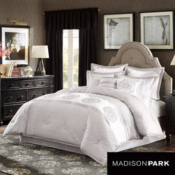 Madison Park - Madison Park Signature Belmont 8-piece Charmeuse Comforter Set - A white horizontal stripe runs through the middle of the Belmont comforter with a circular damask motif drawing attention to this beautiful soft gray quilted comforter. The gray border running alongside the white strip creates a slight sheen.