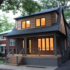 Two storey residential. Black brick, charcoal stucco and T&G cedar siding. Desig